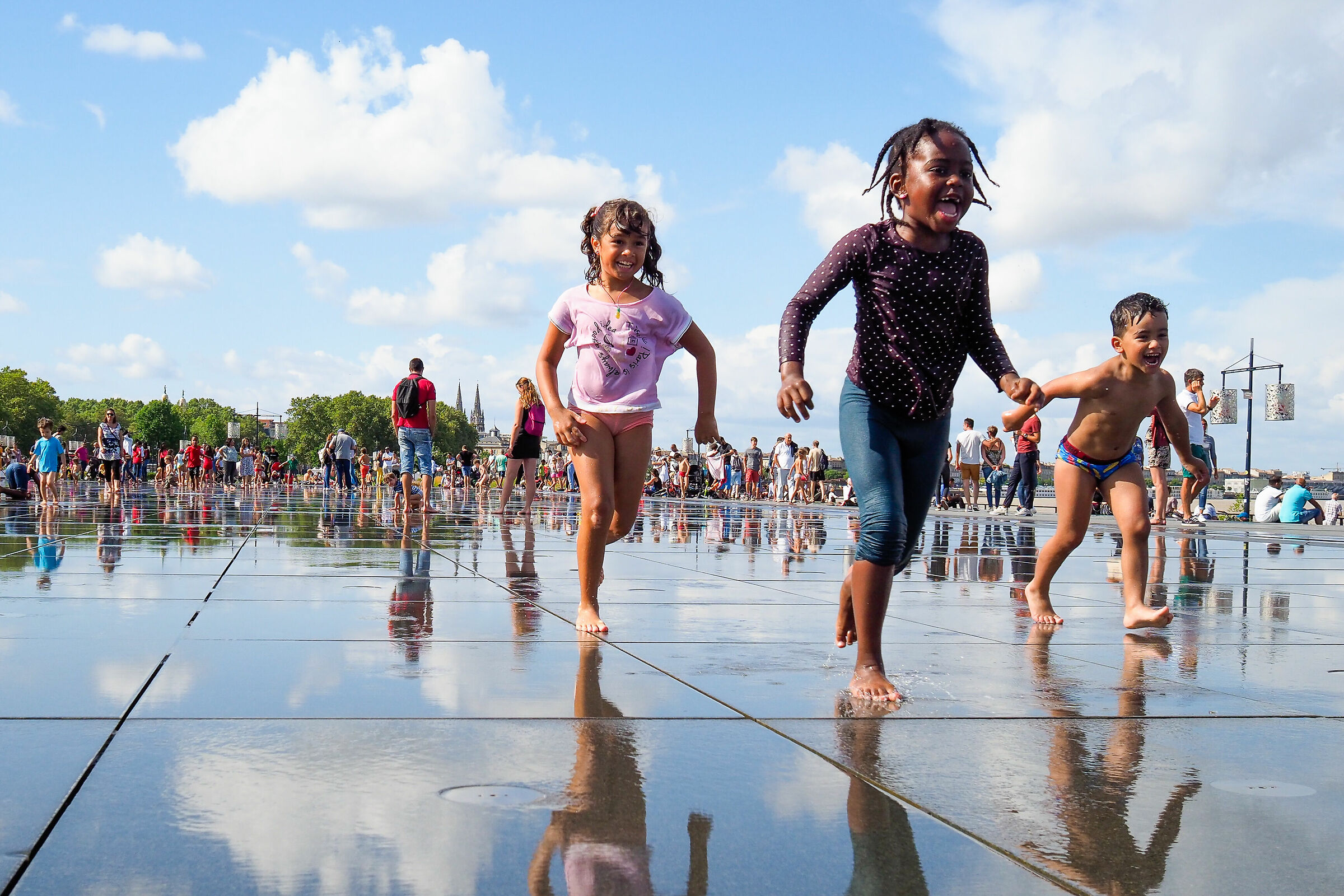 Happy kids at the water mirror of Bordeaux...