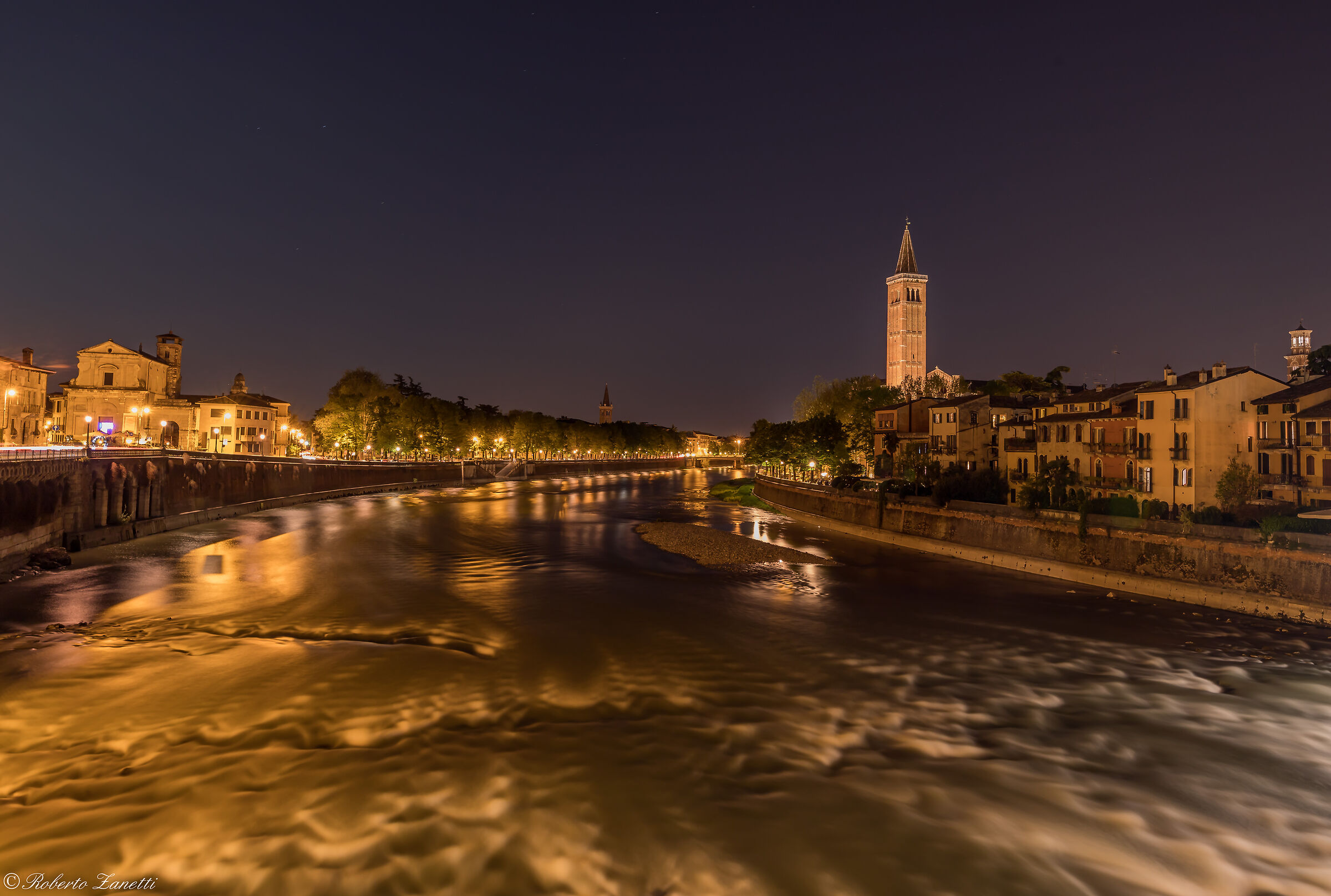 River Adige with bell tower of St. Anastasia...