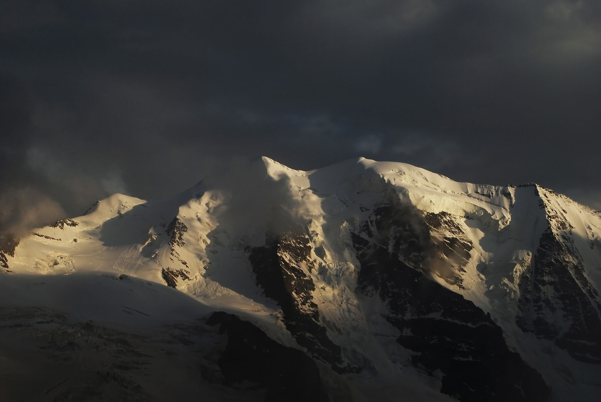Piz Pal, sunny and overwhelmed by menacing clouds...