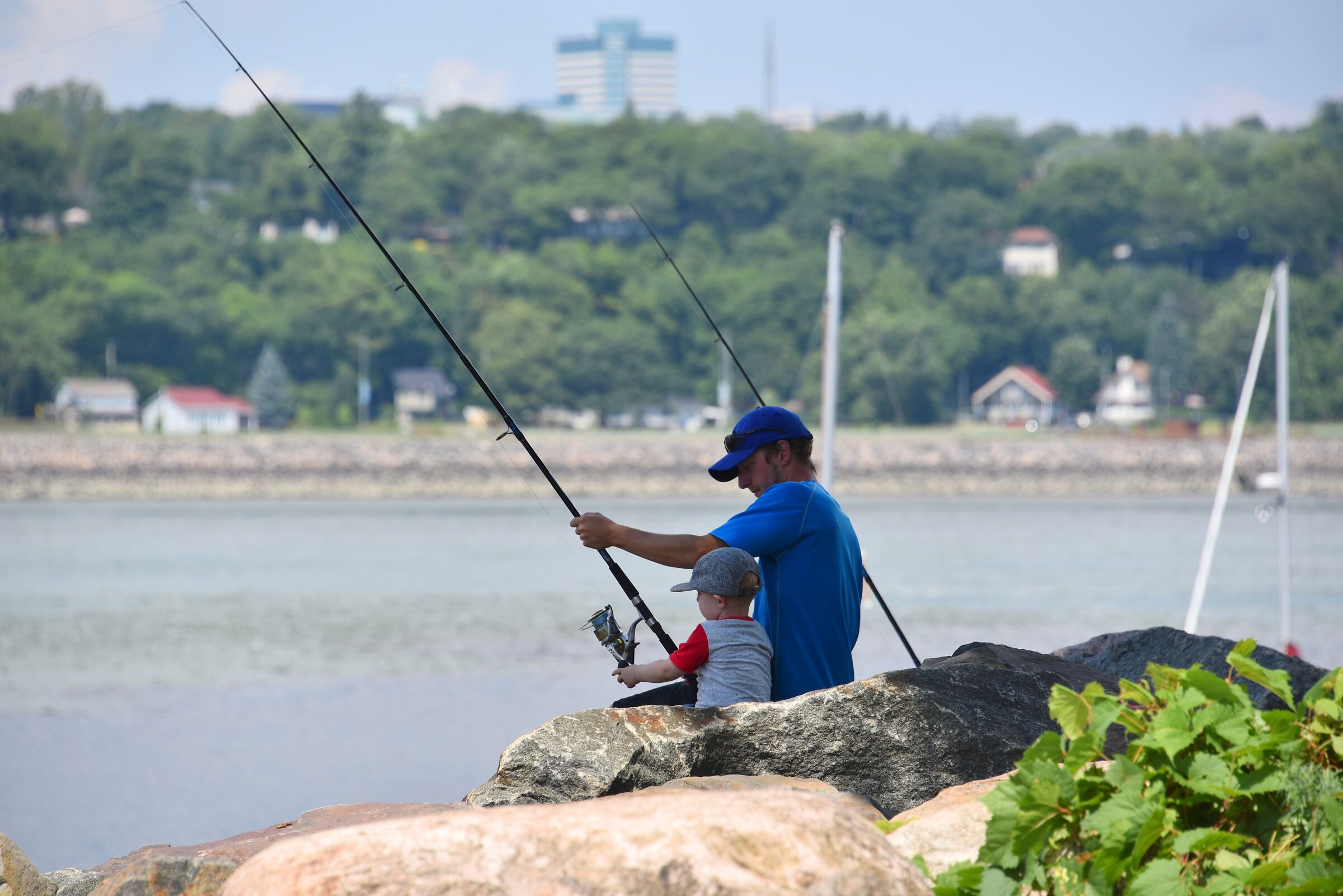 The son and father fishing - Quebec City...