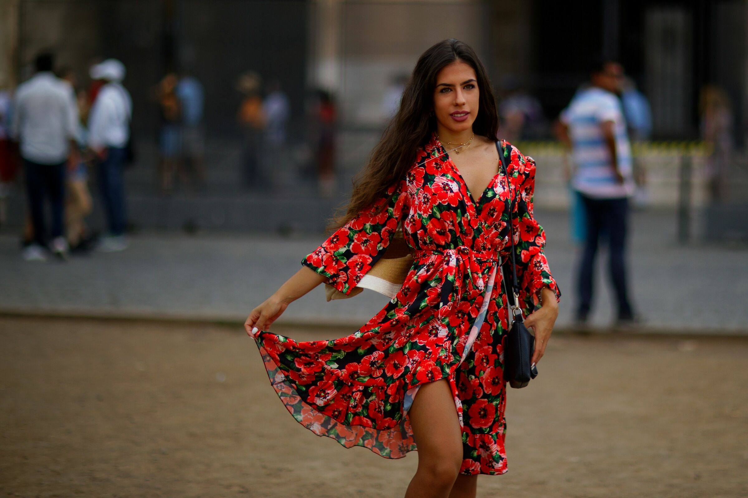a beautiful dress with red flowers...