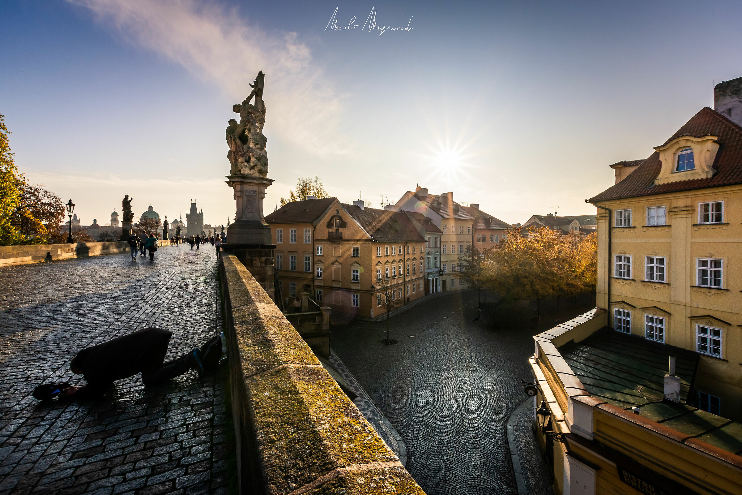 The morning of the beggar on Charles Bridge...