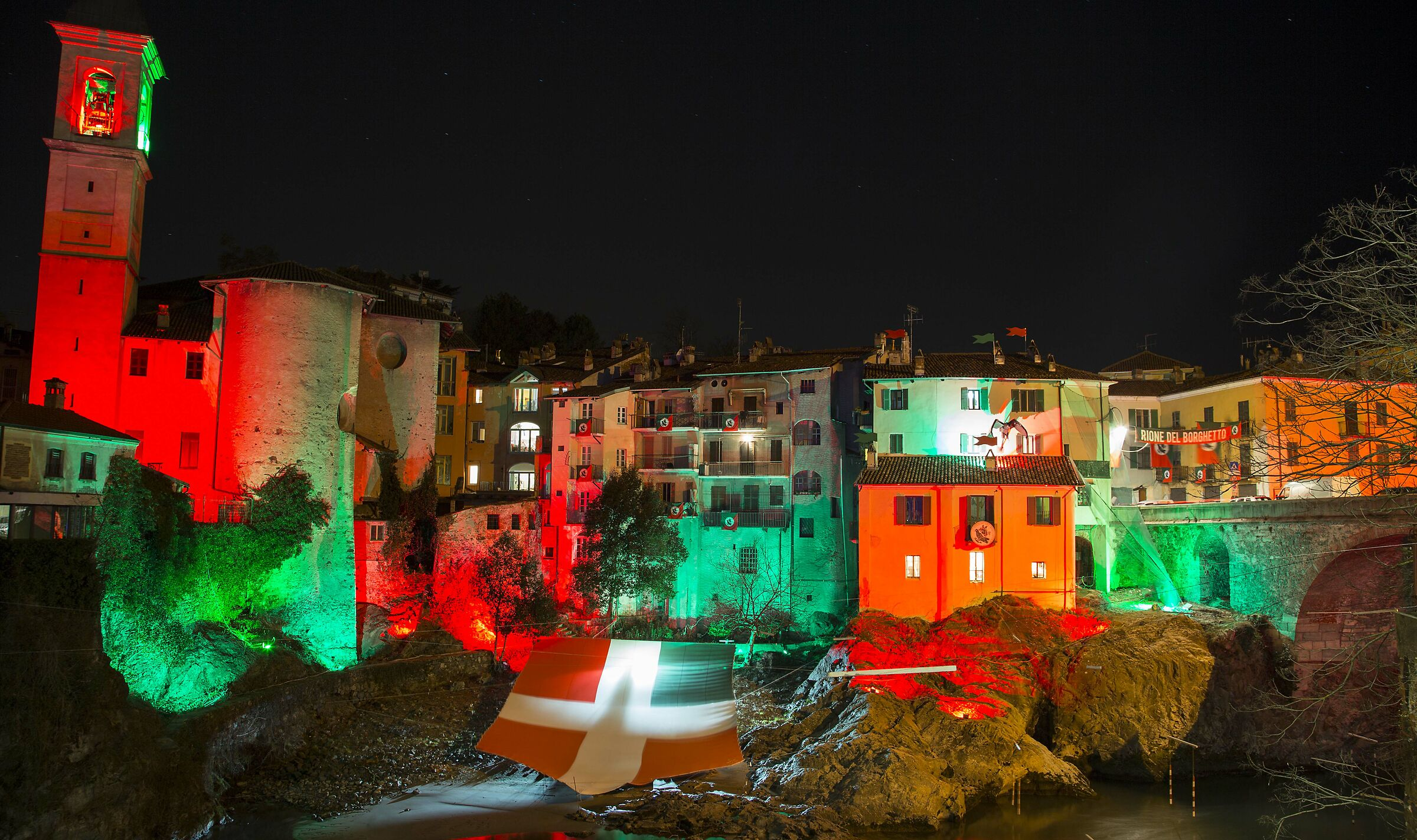 The Old Bridge of Ivrea with the colors of the carnival...