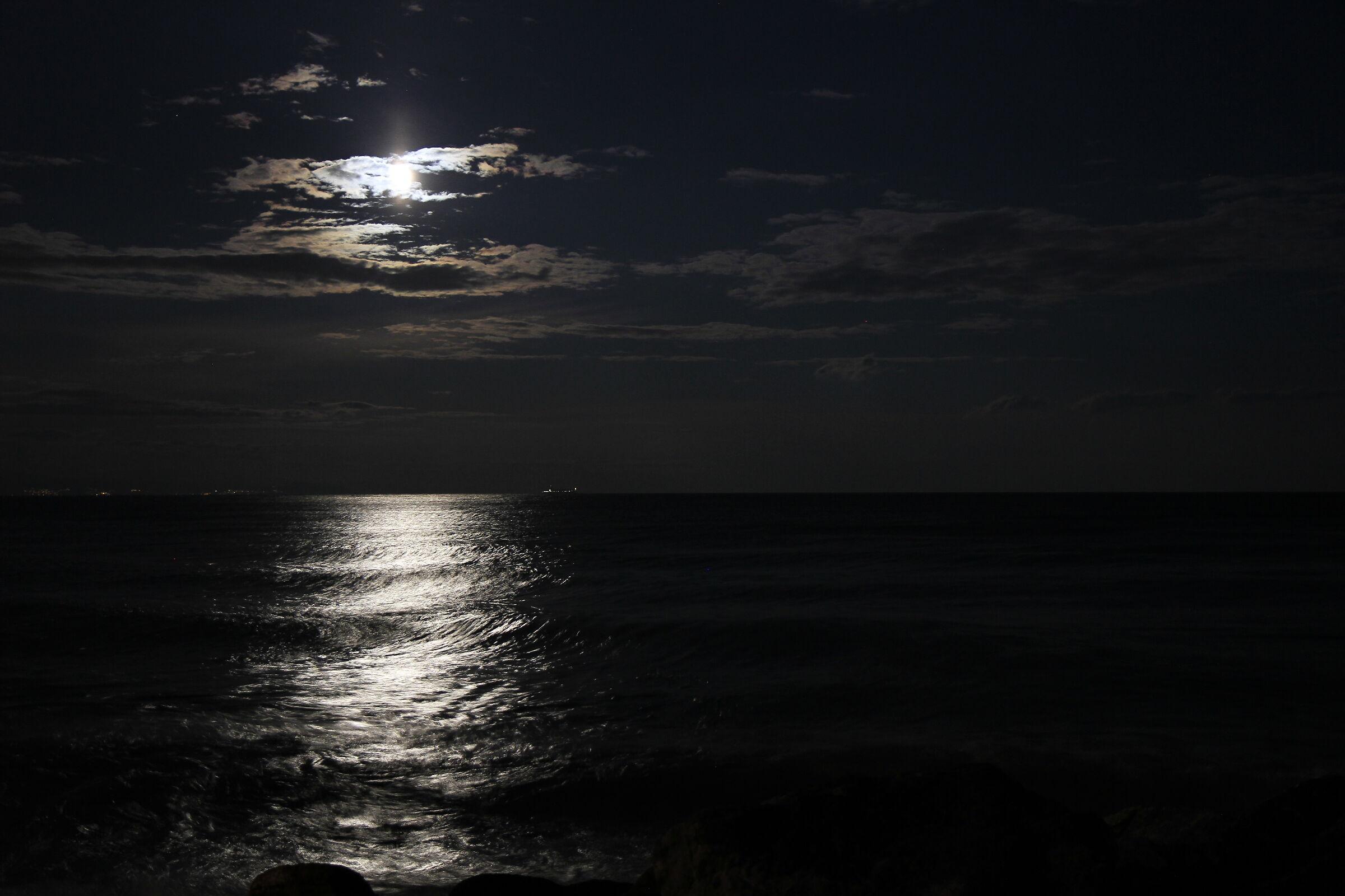 The moon plays hide-and-seek...