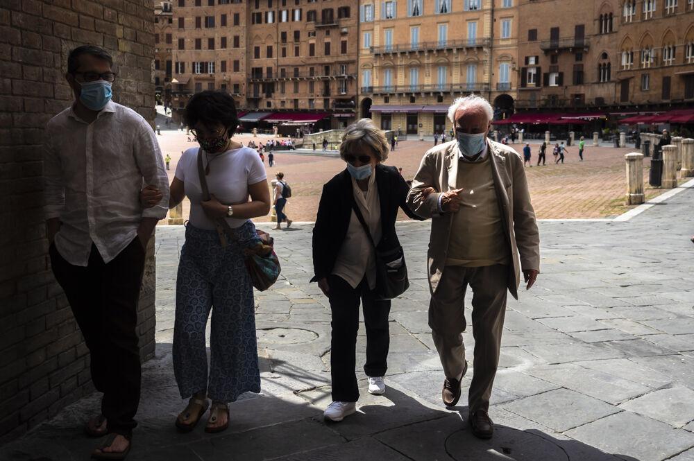 Family walking. Piazza di Campo, Siena...