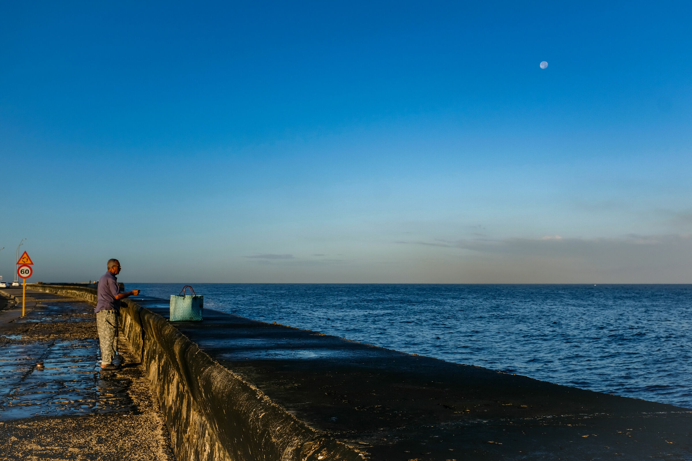 Morning fishing on the Malecon...