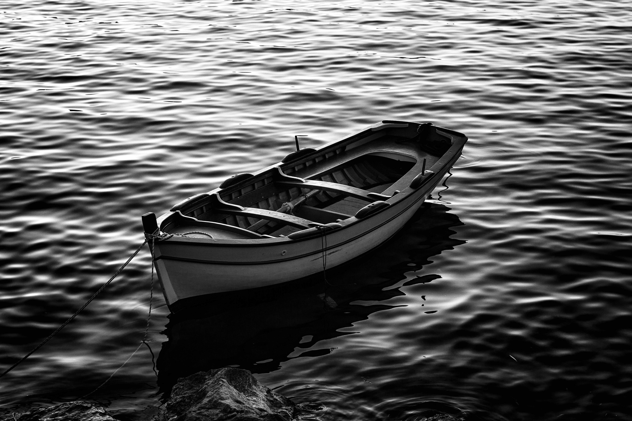 Near the shore, there's an empty boat....